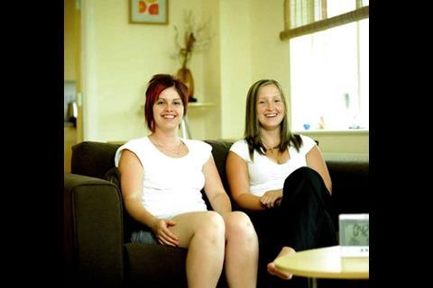 Karrie (left) and Jodie East did not buy their home for its eco-features, but they've been particularly impressed by the Electrisave meter